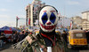 An Iraqi protester wearing the DC comic Joker character's mask poses for a picture during an anti-government demonstration in the capital Baghdad, November 23, 2019. (AFP/File Photo)