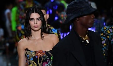 Imaan Hammam, Bella Hadid and Kendall Jenner walk for Versace