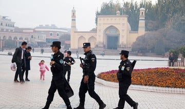 China says interning Muslims brings them into 'modern' world