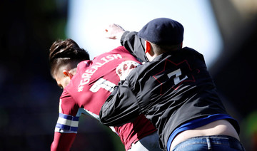 Fan punches Aston Villa's Jack Grealish in the face during derby