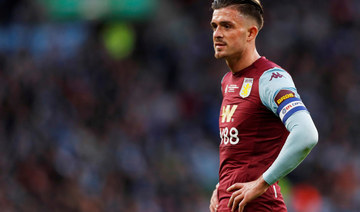 Villa's Grealish apologizes, fined for breaking isolation rules
