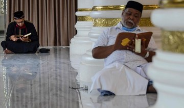 In Aceh, Indonesians pray at mosque during COVID-19 Ramadan, but bring own rugs