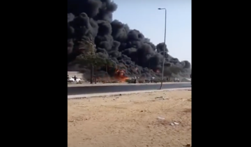 Firefighters battle huge fire at major Cairo highway, 12 injuries reported