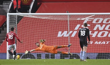Man United beat Villa 2-1, level on points with Liverpool