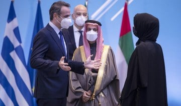 Greek Prime Minister Kyriakos Mitsotakis, left, speaks with Reem Ebrahim Al-Hashimi, Emirati Minister of State for International Cooperation, right and Saudi Foreign Minister Prince Faisal bin Farhan Al-Saud, centrer during a meeting , in Athens, on Thursday, Feb. 11, 2021. (AP)