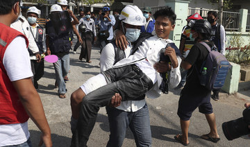A wounded protester is carried during a protest against the military coup in Mandalay, Myanmar, Sunday, Feb. 28, 2021. (AP)
