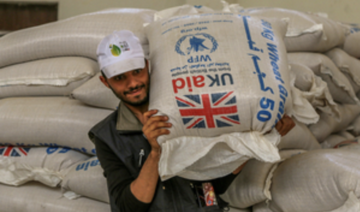 Distribution of UK-funded wheat grain by the World Food Programme in Yemen. (WFP/Ahmed Basha)