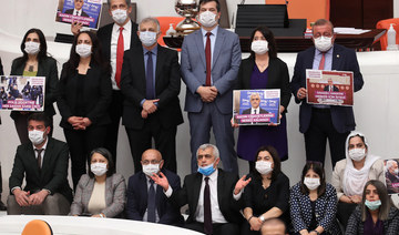 Omer Faruk Gergerlioglu (C), a human rights advocate and lawmaker from the People's Democratic Party (HDP) and his colleagues pose after the parliament stripped his parliamentary seat, in Ankara, on March 17, 2021. (AFP)