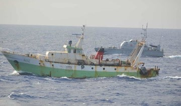 The Libyan patrol boat Ubari approaches an Italian trawler. (Photo: Italian Navy)