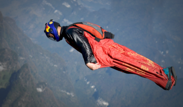 'Like a bird': Asia's top wingsuit athlete soars through central China