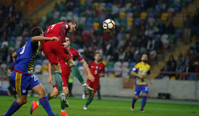 USING HIS HEAD  Portugal s Cristiano Ronaldo heads the ball to score his  second goal against Andorra Saturday during the Portugal vs. Andorra World  Cup 2018 ... 42a7897f6