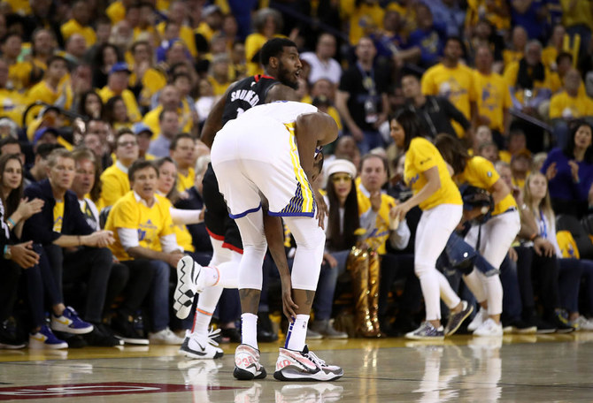 afd4935de Kevin Durant of the Golden State Warriors grabs his ankle after injuring  himself against the Houston Rockets during Game Five of the Western  Conference ...