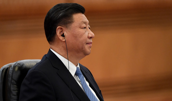 China's Xi turns to financial experts to tame economic risks
