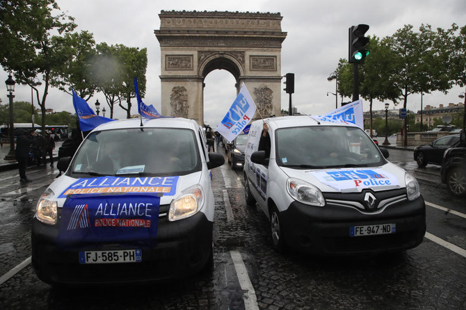French police stage protest on Paris' Champs Elysees