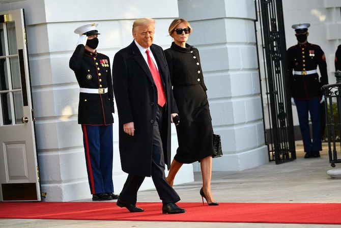 US President Donald Trump and First Lady Melania make their way to board Marine One before departing from the South Lawn of the White House in Washington, DC on January 20, 2021. (AFP)