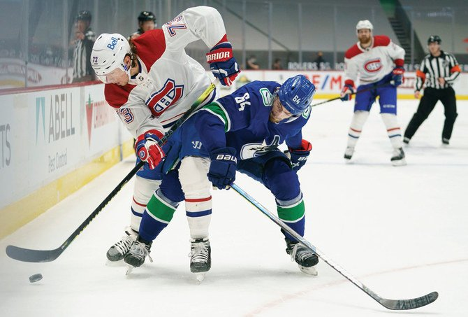 Canadiens beat Canucks 7-3, add to season-opening road run