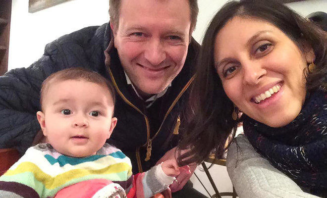 This file photo shows Nazanin Zaghari-Ratcliffe (R) posing for a photograph with her husband Richard and daughter Gabriella (L). (AFP/Free Nazanin campaign)
